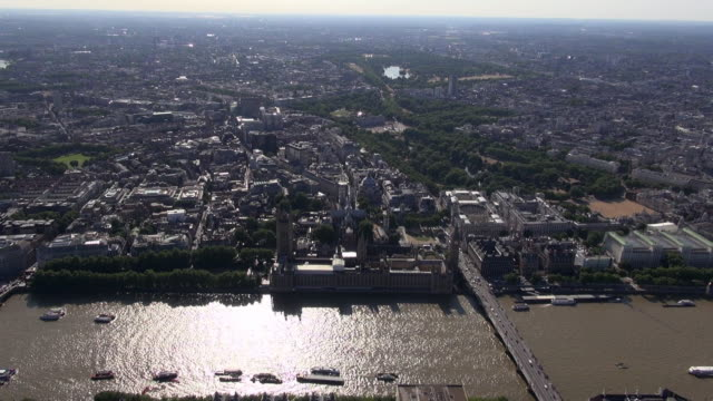 Aerial video of Palace of Westminster, London, and river-front buildings on the River Thames, with Westminster Bridge, St James's Park and Victoria