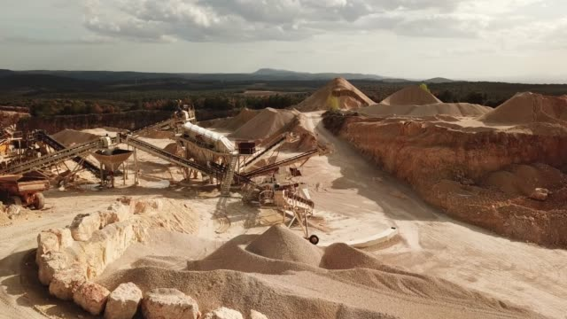 aerial video of quarry in south of france , orgnac , with  materials and machines, 2018 spring - industria mineraria video stock e b–roll