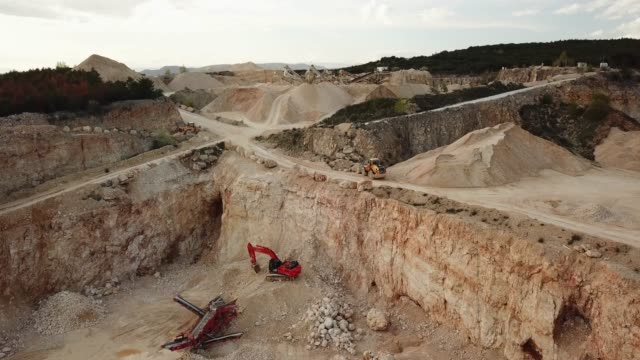 aerial video of quarry in south of france , orgnac , with  materials and machines, 2018 spring - mining stock videos & royalty-free footage
