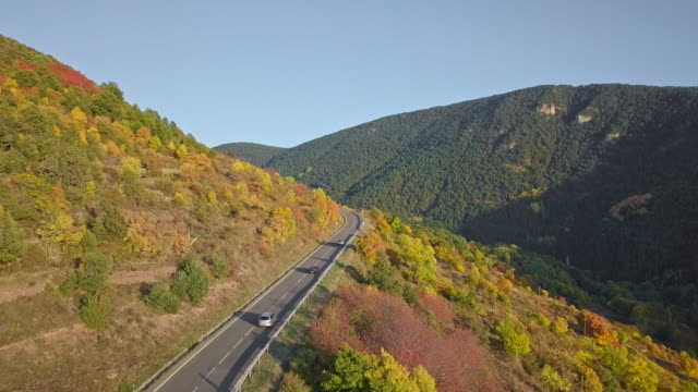 Aerial video of road in the Pyrenees mountain at Autumn season