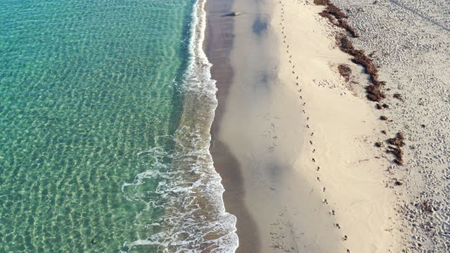 aerial video of sandy beach and clear blue water - drone footage - seascape stock videos & royalty-free footage