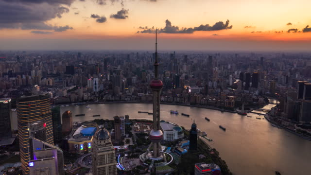 aerial video of shanghai city skyline at dusk - the bund stock videos & royalty-free footage