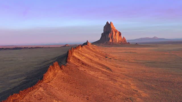 aerial video of ship rock at sunrise, new mexico - drone footage - new mexico stock videos & royalty-free footage