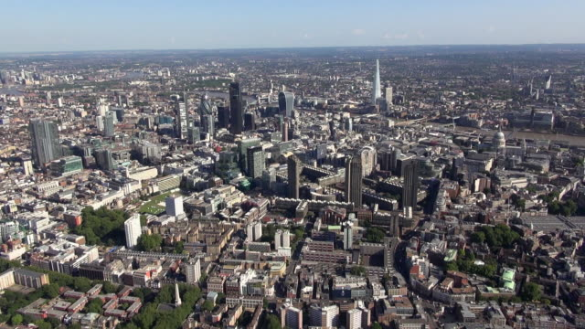 aerial video of the barbican centre looking south east, with views of city of london, river thames, the shard and south london - east london stock videos and b-roll footage