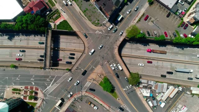 Aerial video of the traffic at the intersection on the bridge over the Highway 95 in New Rochelle, Westchester County, USA