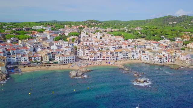 aerial video of the village of calella de palafrugell, costa brava - fishing village stock videos and b-roll footage
