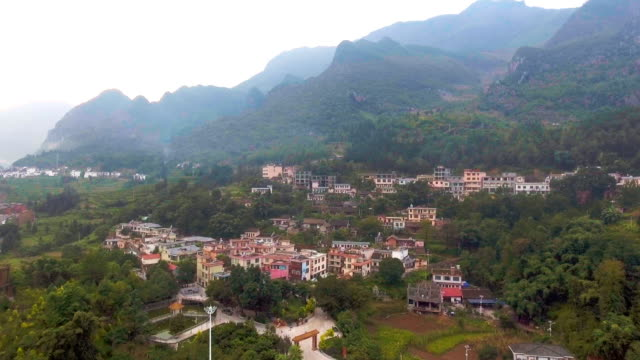 Aerial Video of Tranquil Village Among Valley in Rural Area, China