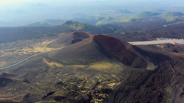 aerial video of volcanic craters, mt etna, sicily, italy - drone footage - 隕石孔点の映像素材/bロール