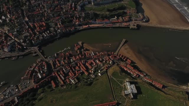 aerial video of whitby harbour-north yorkshire seaside town - whitby north yorkshire england stock videos & royalty-free footage