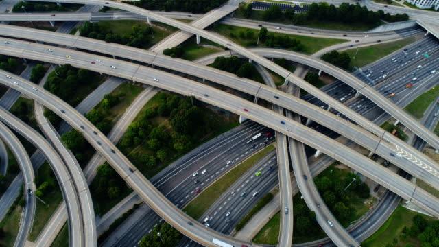 aerial video on top of highway road junctions - motorway junction stock videos & royalty-free footage
