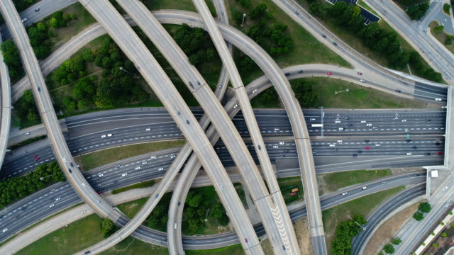 aerial video on top of highway road junctions - urban road stock videos & royalty-free footage