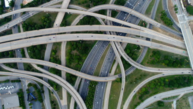 aerial video on top of highway road junctions - overhead view stock videos & royalty-free footage