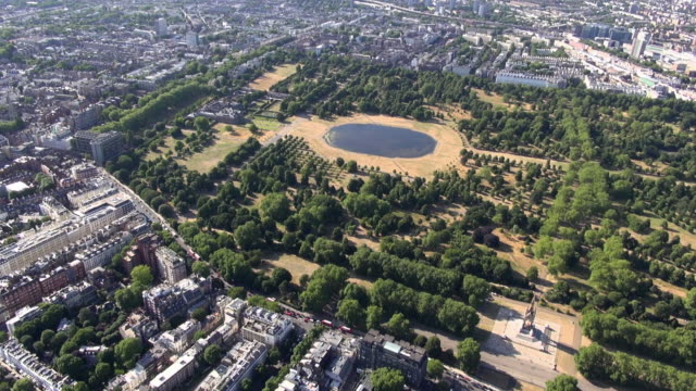 aerial video panning round from kensington and kensington gardens to the albert memorial, royal albert hall and knightsbridge - royal albert hall stock videos & royalty-free footage