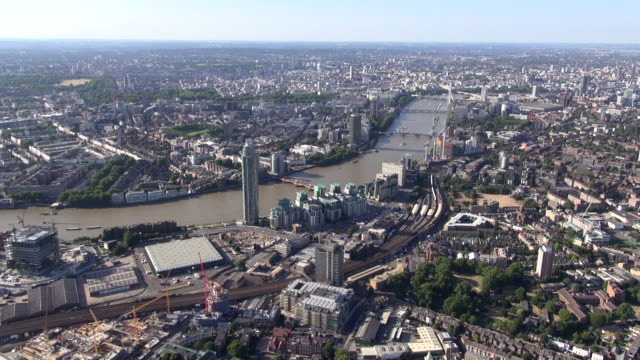 Aerial video panorama north along the River Thames from Vauxhall and Kennington with New Covent Garden at Nine Elms and St George Wharf in foreground and views over north London