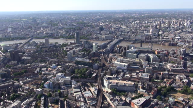 aerial video panorama of southwark, blackfriars bridge and river thames along to waterloo station, the london eye  and lambeth, with views north of the river - lambeth stock videos & royalty-free footage