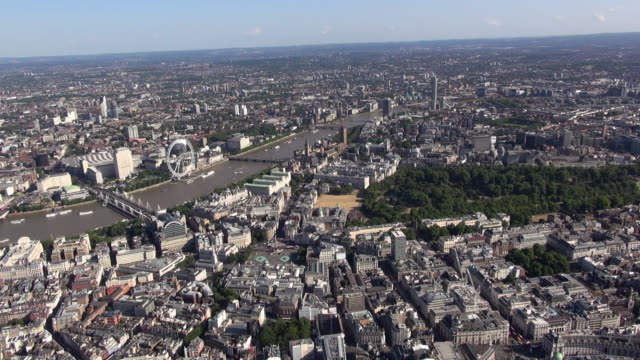 aerial video panorama over westminster moving southwards past trafalgar square towards hungerford bridge and london eye, with distant views over south west london - hungerford bridge stock videos & royalty-free footage