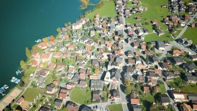 aerial video taken in the lungern city, switzerland - geplante wohnsiedlung stock-videos und b-roll-filmmaterial