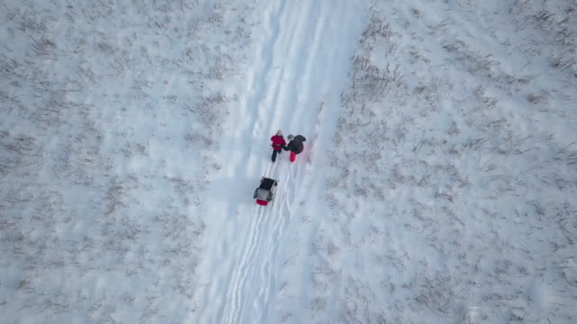 4K Aerial Video View Family Snowshoeing Walking Outdoor in winter