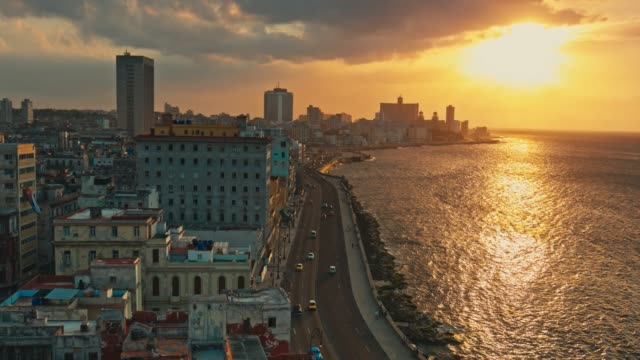 aerial video view of malecon in havana at sunset - cuba video stock e b–roll