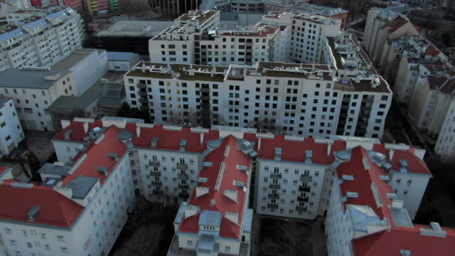 aerial: vienna apartment blocks and cityscape with mountains behind, austria - flat stock videos & royalty-free footage