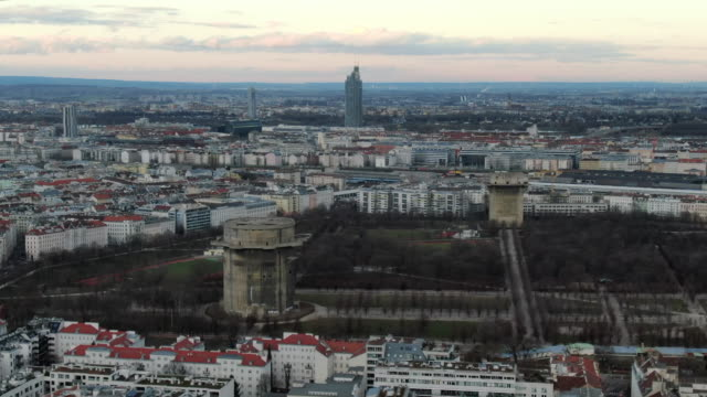 aerial: vienna cityscape with augarten park and flak towers, austria - vienna austria stock videos & royalty-free footage