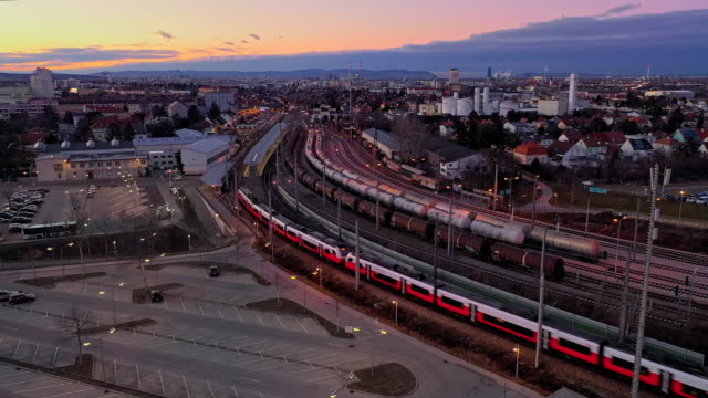ws aerial viev train moving through cityscape - austria stock videos & royalty-free footage