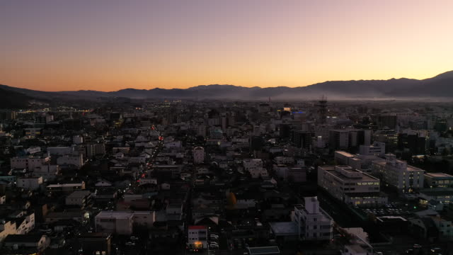 aerial view 4k video by drone of building in matsumoto city, nagano. - 夜明け点の映像素材/bロール