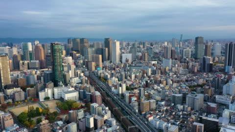 osaka, japan. aerial view 4k video by drone of building in osaka city. - bahnhof osaka stock-videos und b-roll-filmmaterial