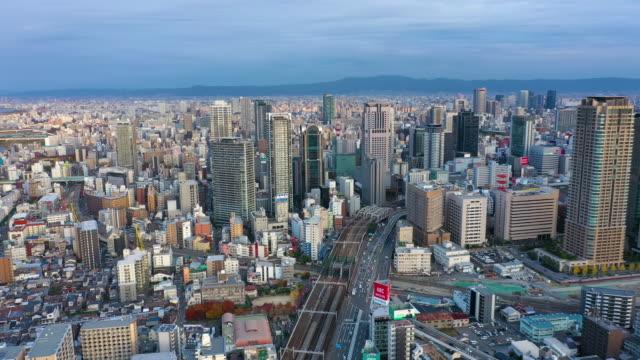 osaka, japan. aerial view 4k video by drone of building in osaka city. - 大阪駅点の映像素材/bロール