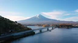 Aerial view 4k video by drone of Mount Fuji and bridge at Kawaguchi lake, Japan.