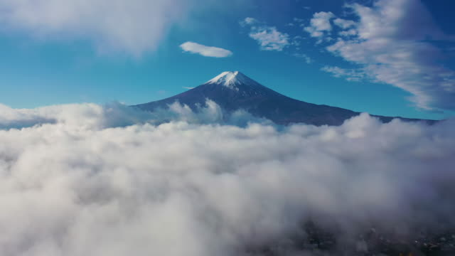 aerial view 4k video by drone of mount fuji and mist at yamanashi , japan. - mt fuji stock videos & royalty-free footage