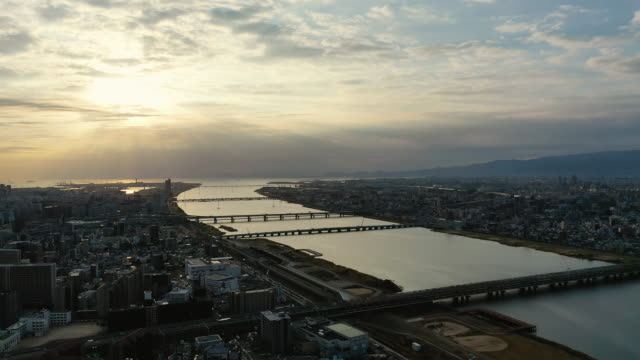 aerial view 4k video by drone of river and building in osaka city, japan. - 大阪駅点の映像素材/bロール