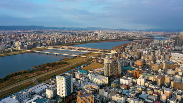 aerial view 4k video by drone of river and building in osaka city. - 大阪駅点の映像素材/bロール