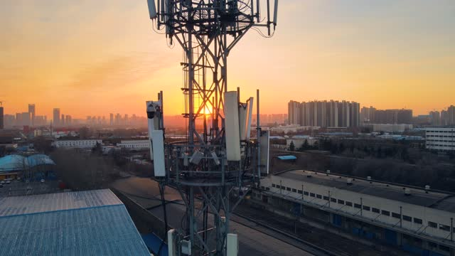aerial view 5g cellular communications tower - mast stock videos & royalty-free footage