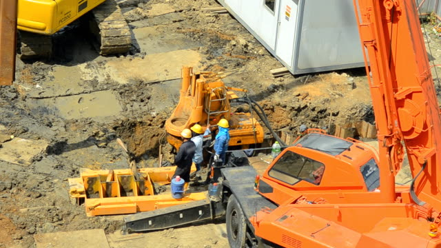 aerial view: a crane truck is built steel stake - construction vehicle stock videos & royalty-free footage