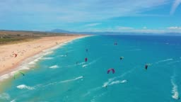 Aerial view. a large beach filled with kite surfers in tarifa, Spain