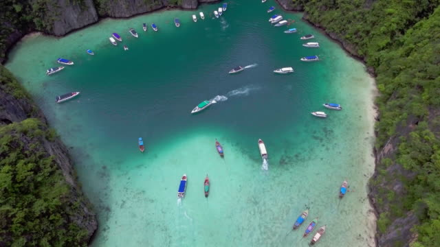 aerial view a paradise with speed boat and perfect crystal clear - lagoon stock videos and b-roll footage