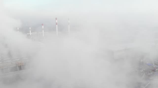 aerial view /a power plant that is working to generate electricity to large cities - physical pressure stock videos & royalty-free footage