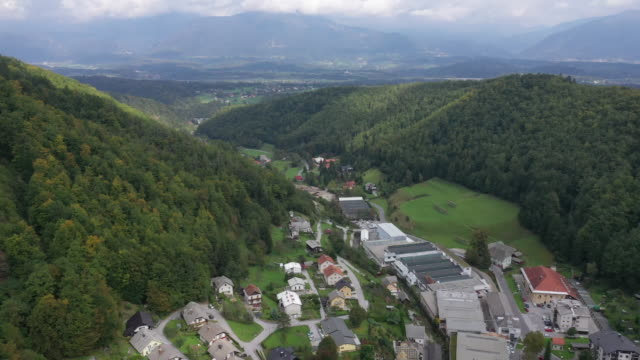 aerial view a small village on the mountain, slovenia - slovenia stock videos & royalty-free footage