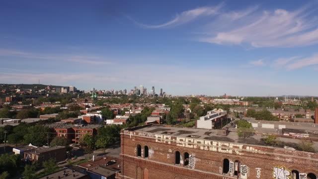 stockvideo's en b-roll-footage met aerial view above abandoned factory to ws of montreal - verlaten slechte staat