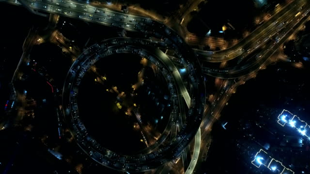 aerial view above of busy highway road junctions at night,nanpu bridge at shanghai,china - spiral stock videos and b-roll footage