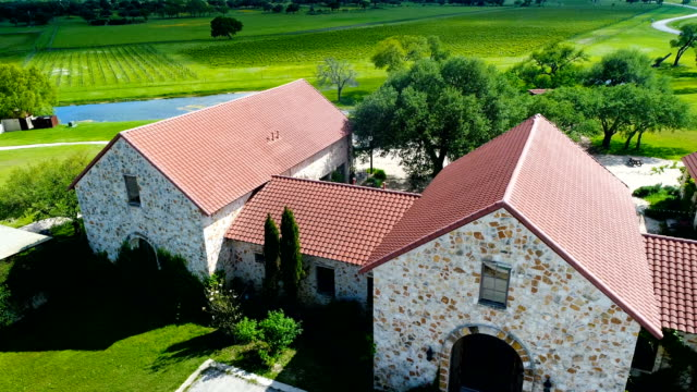 aerial view above ranch homes with wine fields in the background - texas stock videos & royalty-free footage