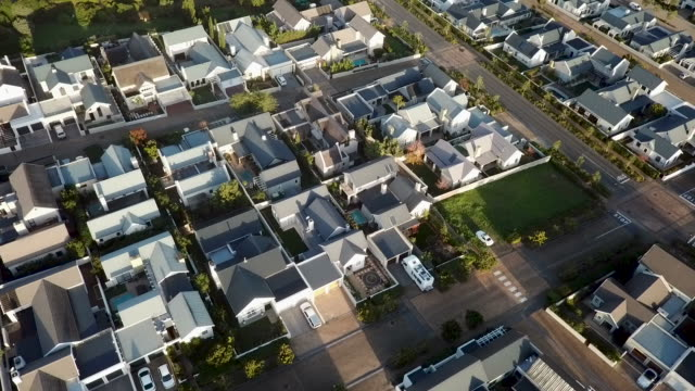 aerial view above suburb of new houses - south africa stock videos & royalty-free footage