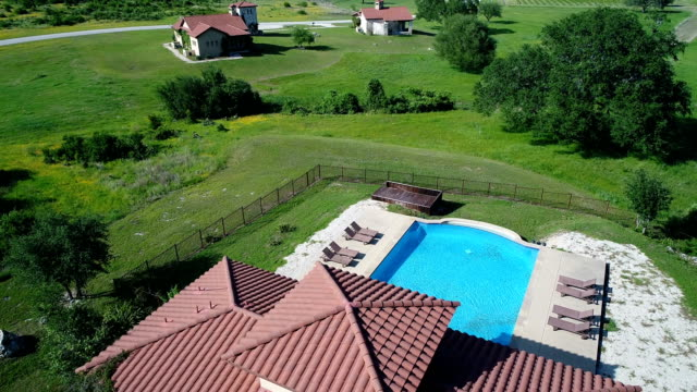 aerial view above swimming pool at ranch homes on winery - ranch stock videos & royalty-free footage