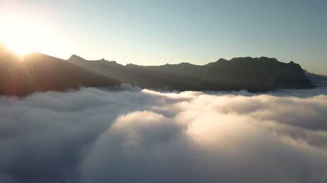 aerial view above the clouds and mountain with sunrise - named wilderness area stock videos & royalty-free footage