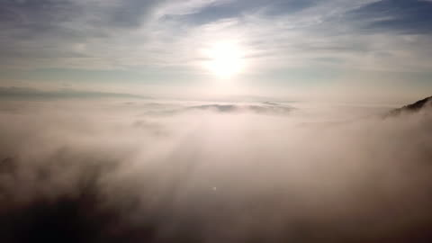 aerial view above the clouds and sky in sunrise time , inspiration concept - sky only stock videos & royalty-free footage