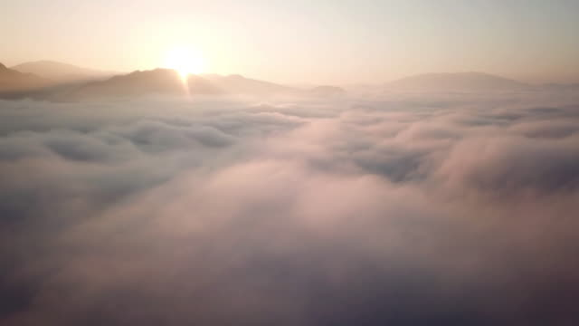 aerial view above the clouds and sky in sunrise time , inspiration concept - panorama di nuvole video stock e b–roll