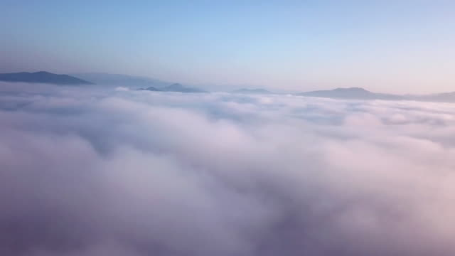 aerial view above the clouds and sky in sunrise time , inspiration concept - stratosphere stock videos & royalty-free footage