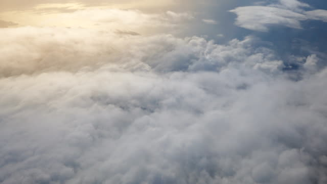 aerial view above the clouds - moving past stock videos & royalty-free footage