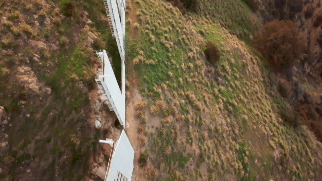 aerial view above the hollywood sign - academy of motion picture arts and sciences stock videos & royalty-free footage